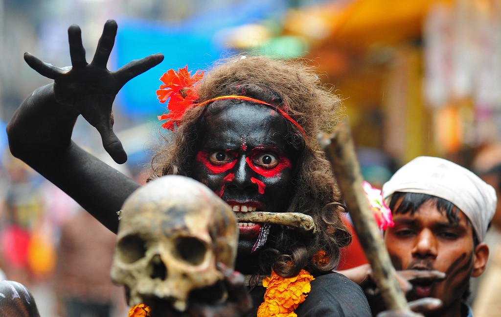 . An Indian Hindu devotee holds a human skull during a procession for Maha Shivaratri, dedicated to the Hindu god Lord Shiva, in Allahabad on February 27, 2014. Hindus mark the Maha Shivratri festival by offering special prayers and fasting to Lord Shiva, the god of destruction. AFP PHOTO/SANJAY  Kanojia/AFP/Getty Images