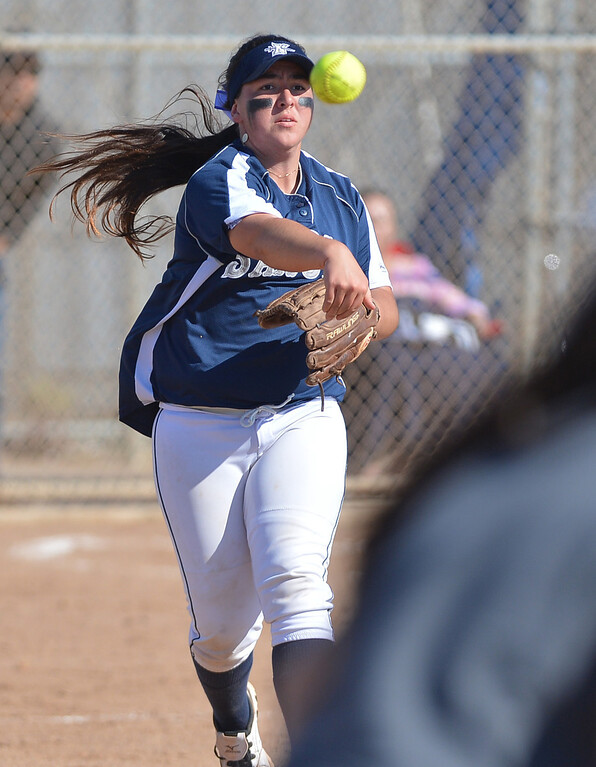 . 0314_SPT_TDB_L_CAR-NORTH--- Torrance, CALIFORNIA--3/13/13--- Staff Photo: Robert Casillas / LANG--- Carson at North Torrance softball. North 3rd baseman Tessa Tomaselli throws out a runner at first.