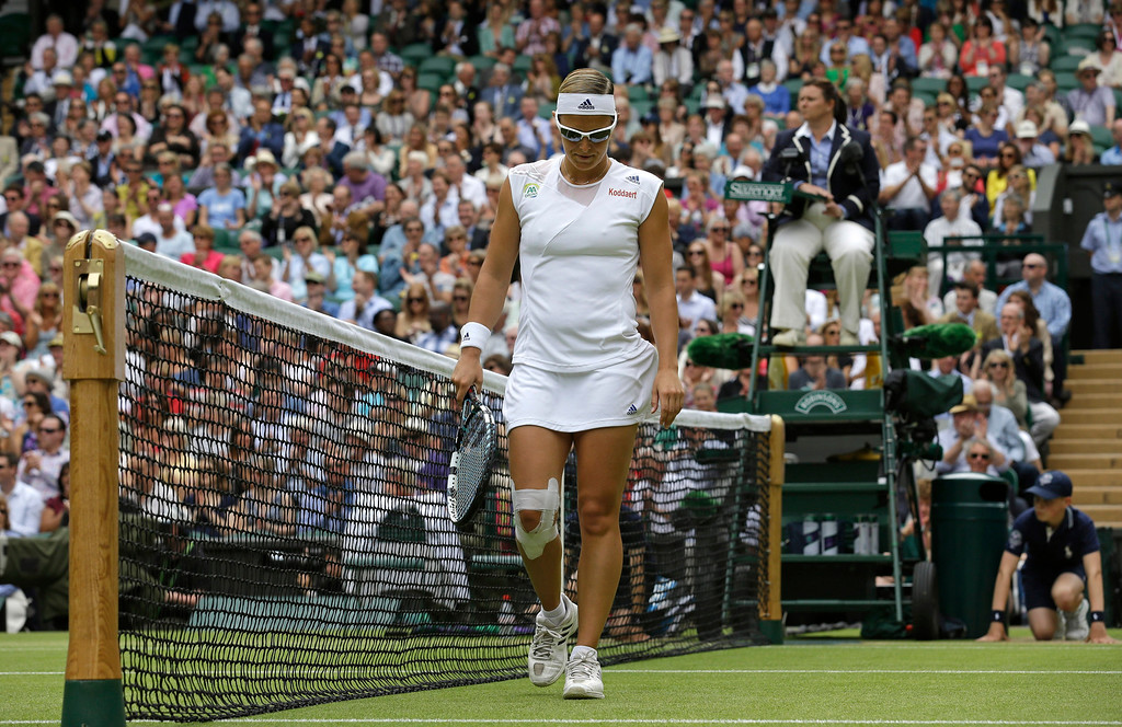 . Kirsten Flipkens of Belgium reacts after missing a return to Marion Bartoli of France during their Women\'s singles semifinal match at the All England Lawn Tennis Championships in Wimbledon, London, Thursday, July 4, 2013. (AP Photo/Anja Niedringhaus)