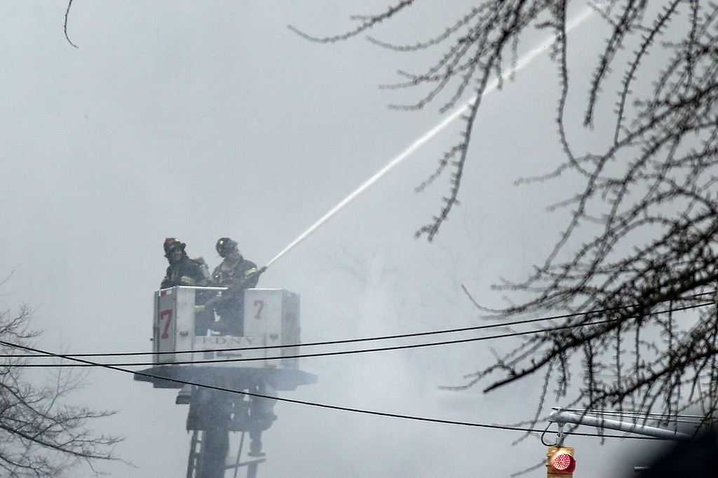 . New York firefighters battle a blaze at a commercial and residential block on March 26, 2015, in New York\'s East Village. The entire building at 125 Second Avenue was engulfed in flames and the lower two floors appeared partially collapsed, television footage and press photographs showed. Twelve people were reported hurt by fire department officials. AFP PHOTO/KENA BETANCURKENA BETANCUR/AFP/Getty Images