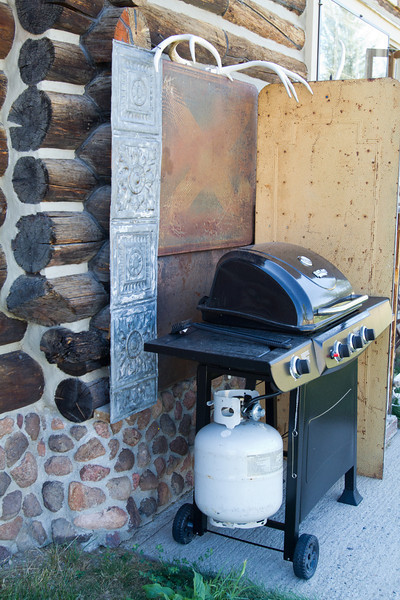 Protective coverings between the log cabin and the BBQ