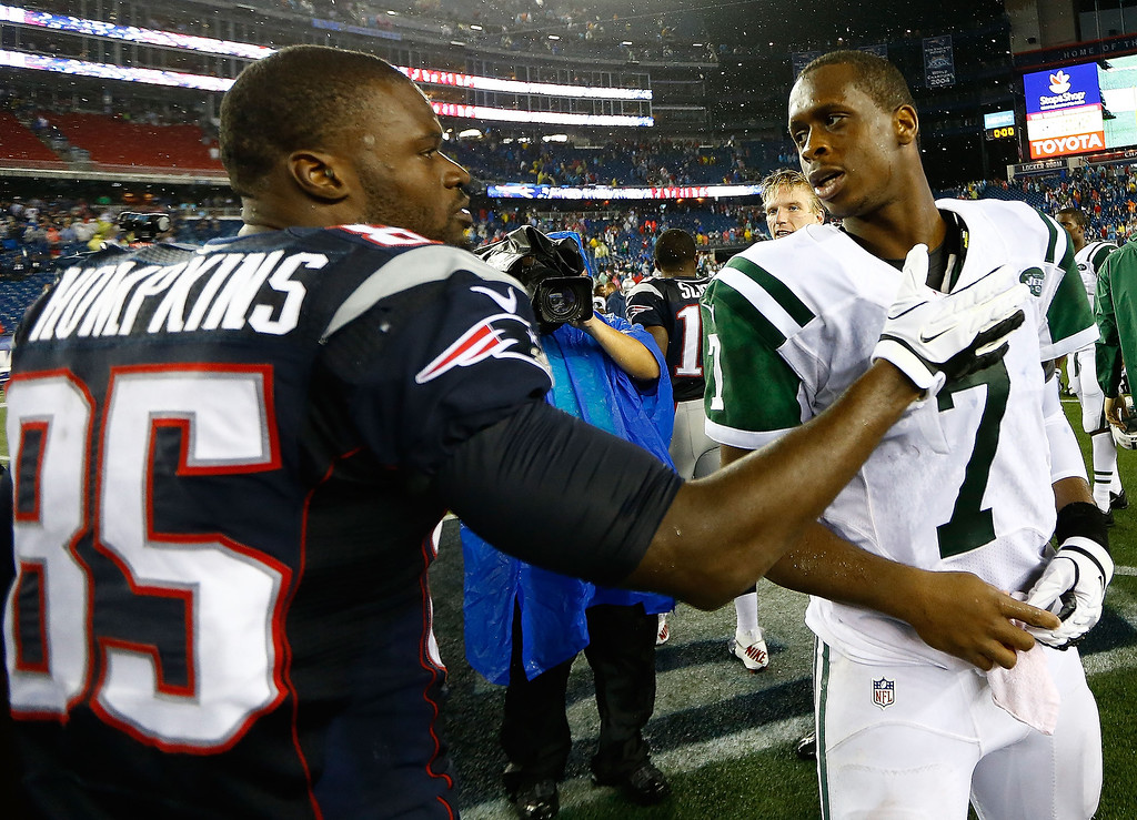. Geno Smith #7 of the New York Jets is greeted by Kenbrell Thompkins #85 of the New England Patriots following the Jets 10-13 loss during the game at Gillette Stadium on September 12, 2013 in Foxboro, Massachusetts. (Photo by Jared Wickerham/Getty Images)