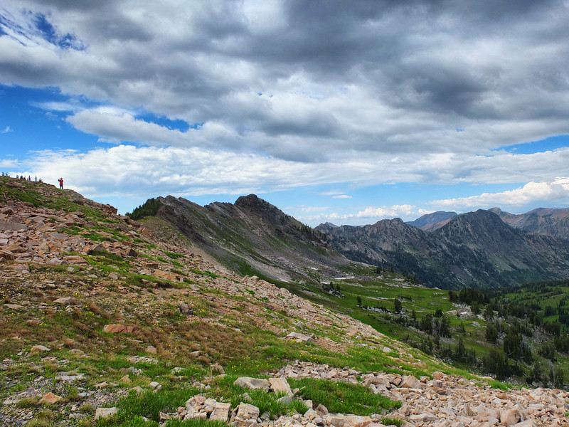 An archaeologist looks out over unexplored country in the Teton Range, Wyoming