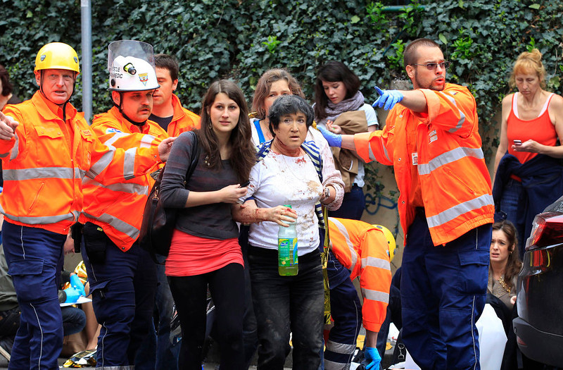 . Paramedics help injured people after an explosion in downtown Prague, Czech Republic, Monday, April 29, 2013.  Police said a powerful explosion has damaged a building in the center of the Czech capital and they believe some people are buried in the rubble. (AP Photo/Petr David Josek)