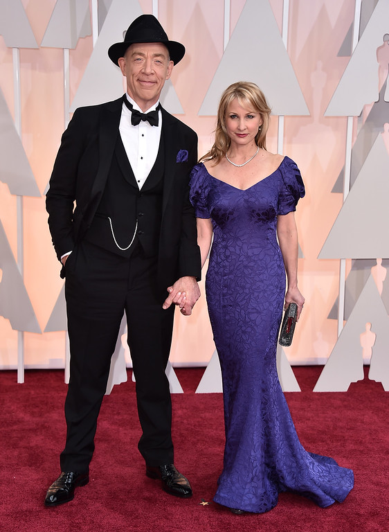 . J.K. Simmons, left, and Michelle Schumacher arrive at the Oscars on Sunday, Feb. 22, 2015, at the Dolby Theatre in Los Angeles. (Photo by Jordan Strauss/Invision/AP)