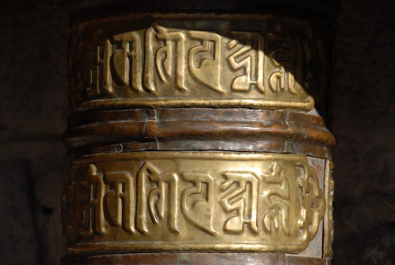 Old brass Tibetan Buddhist prayer wheel.  Ladakh, India
