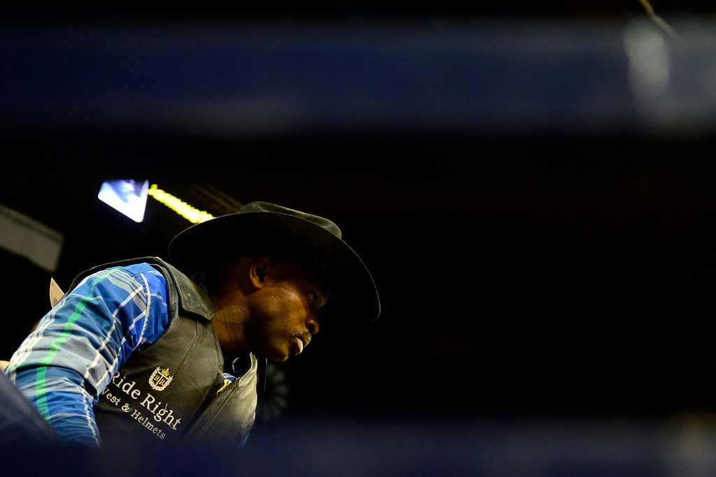 . DENVER, CO. - JANUARY 21:  Jimmy Patterson prepares for his ride in the chutes at the National Western Stock Show Martin Luther King Heritage Rodeo January 21, 2013 (Photo By AAron Ontiveroz / The Denver Post)