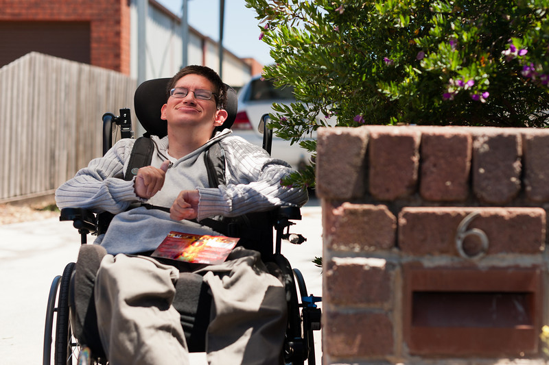Young Man getting his Mail, seated in his wheelchair