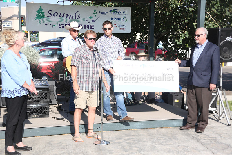 Havre Daily News / Floyd Brandt  ROC Really Old Country performed in Havre Town Square Wednesday. Triangle Communications and Northwest Energy donated to Sounds in Town Square Left Jodi Olson , Joe Ross from Havre Chamber of Commerce except a check from Carson Sweeney and Craig Gates