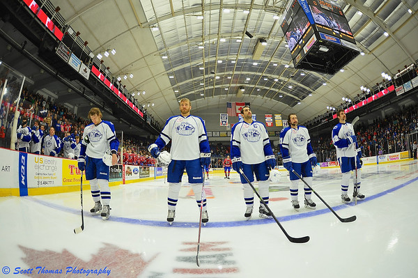 Syracuse Crunch starting lineup, Dmitry Korobov (44, Belarus), Geoff Walker (67, Canada), Mike Angelidis (10, Canada), Drew Olson (21, USA) and Luke Witkowski (82, USA) before playing the Hamilton Bulldogs in an American Hockey League (AHL) game at the Onondaga County War Memorial on Saturday, November 23, 2013.