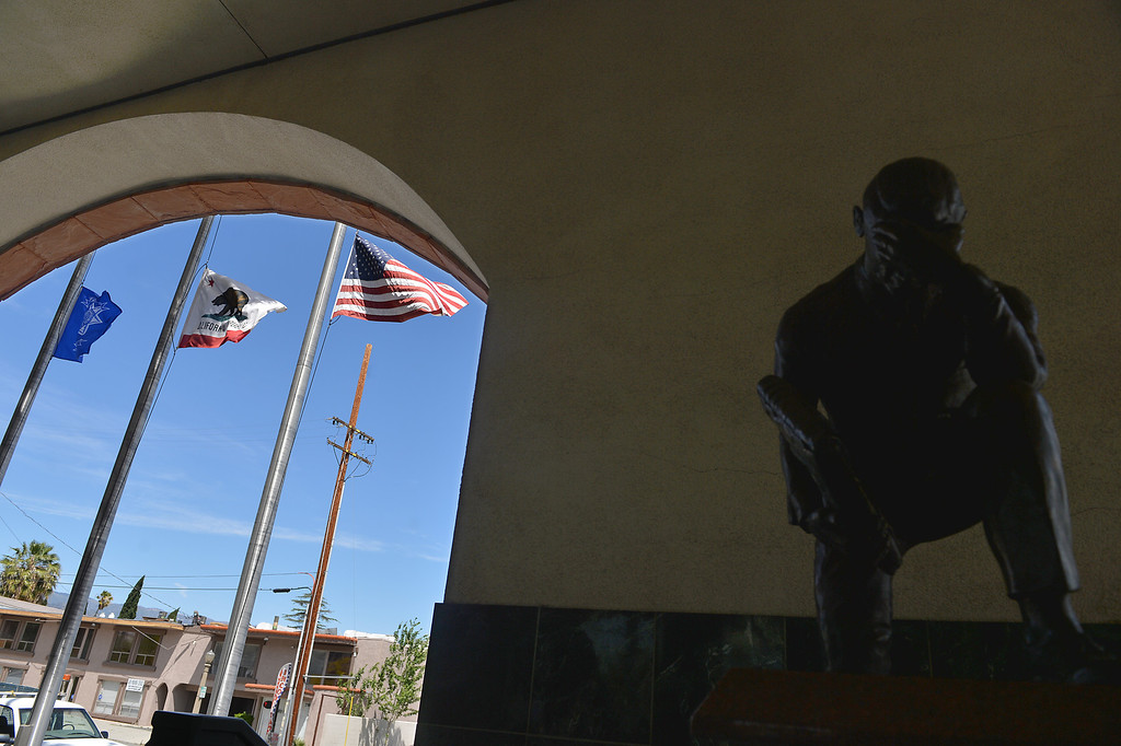 . Flags fly half staff outside San Bernardino police department where a press conference is held to discuss the death of Officer Shaun Jarvis, 30, of Beaumont, a motorcyle officer, who died in an off-duty crash on the 91 Freeway on Thursday April 30, 2014. (Photo by Rick Sforza/The Sun)