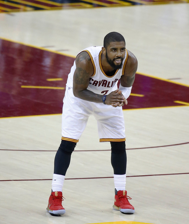 . Cleveland Cavaliers guard Kyrie Irving reacts during play against the Golden State Warriors during the first half of Game 4 of basketball\'s NBA Finals in Cleveland, Friday, June 9, 2017. (AP Photo/Ron Schwane)