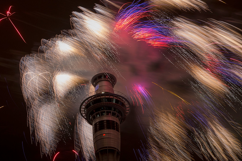 . AUCKLAND, NEW ZEALAND - JANUARY 01:  Firework display from the top of the Sky Tower to welcome the New Year on January 1, 2015 in Auckland, New Zealand.  (Photo by Dave Rowland/Getty Images)