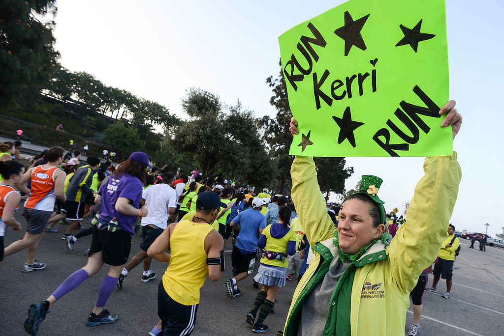 . Janelle Anderson of Bakersfield cheers on family members at the start of the LA Marathon Sunday at Dodger Stadium. Photo by David Crane/Staff Photographer