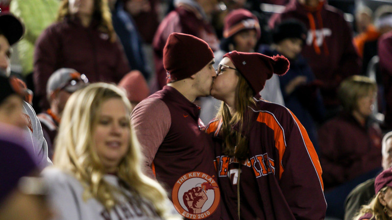 Hokies fans keep warm in the stands as Miami pulls away in the second half. (Mark Umansky/TheKeyPlay.com)
