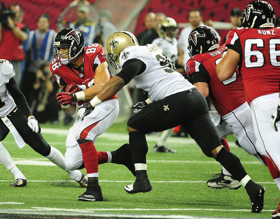 . Tony Gonzalez #88 of the Atlanta Falcons is tackled by Tom Johnson #96 the New Orleans Saints at the Georgia Dome on November 21, 2013 in Atlanta, Georgia. (Photo by Scott Cunningham/Getty Images)