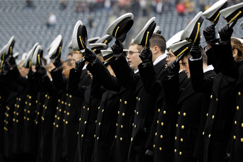 . Navy Midshipmen tip their hats as they march on the field before an NCAA college football game against Army, Saturday, Dec. 8, 2012, in Philadelphia. (AP Photo/Matt Slocum)