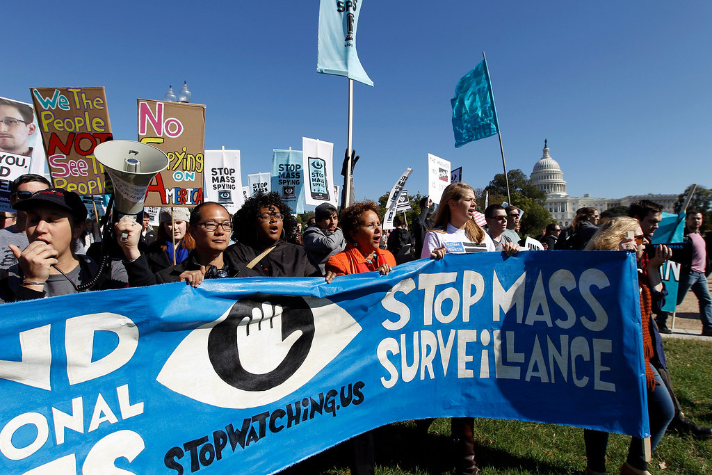 . Demonstrators march on the National Mall in Washington to rally and demand that the U.S. Congress investigate the National Security Agency\'s mass surveillance programs Saturday, Oct. 26, 2013. ( AP Photo/Jose Luis Magana)