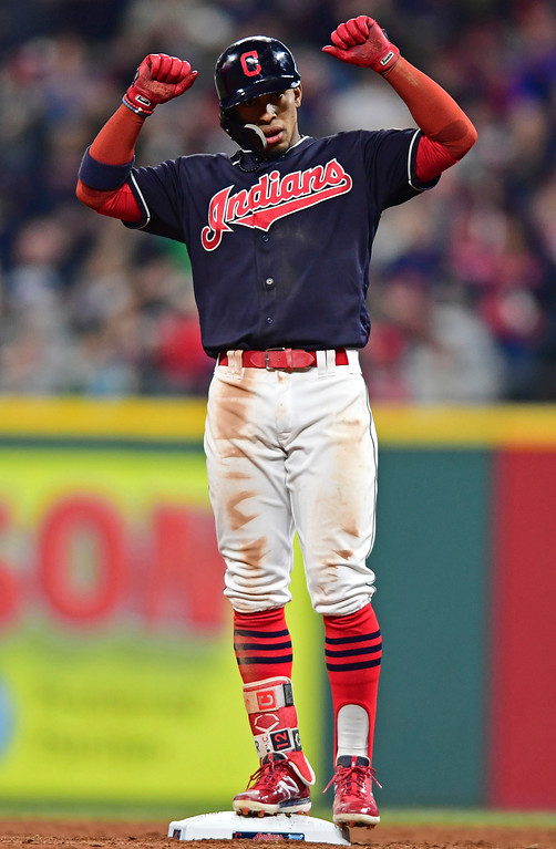 . Cleveland Indians\' Francisco Lindor celebrates after hitting a double in the sixth inning of a baseball game against the Toronto Blue Jays, Friday, April 13, 2018, in Cleveland. The Blue Jays won 8-4. (AP Photo/David Dermer)