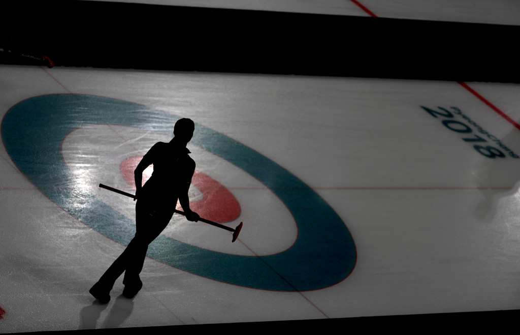 . Canada\'s Lisa Weagle stands on the ice during a women\'s curling match against China at the 2018 Winter Olympics in Gangneung, South Korea, Tuesday, Feb. 20, 2018. (AP Photo/Natacha Pisarenko)