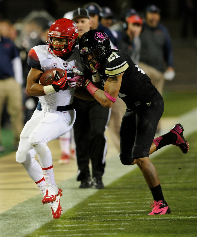 . BOULDER, CO. - OCTOBER 26: Colorado defensive back Jered Bell (21) pushed Arizona wide receiver Nate Phillips (6) out of bounds in the first half. The University of Colorado football team hosted Arizona Saturday night, October 26, 2013. Photo By Karl Gehring/The Denver Post