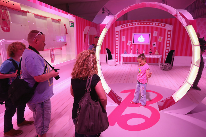 . Tanja (R) and her family visit the Barbie Dreamhouse Experience on May 16, 2013 in Berlin, Germany. The Barbie Dreamhouse is a life-sized house full of Barbie fashion, furniture and accessories and will be open to the public until August 25 before it moves on to other cities in Europe.  (Photo by Sean Gallup/Getty Images)