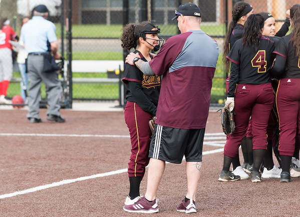 04/29/19 Wesley Bunnell | Staff New Britain softball defeated Conard at Chesley Park on Monday afternoon. Xandra Silva (3) smiles while speaking to head coach Joel Simmone.