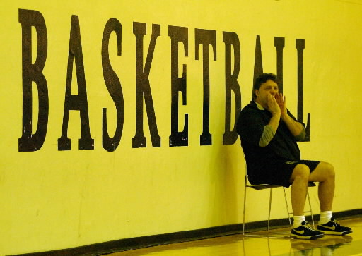 Description of . Oakland University men's basketball head coach Greg Kampe yells instructions to his team during practice held at the Mabee Center, on the campus of Oral Roberts University in Tulsa, OK, Friday, March 2, 2007.  (The Oakland Press/Jose Juarez)