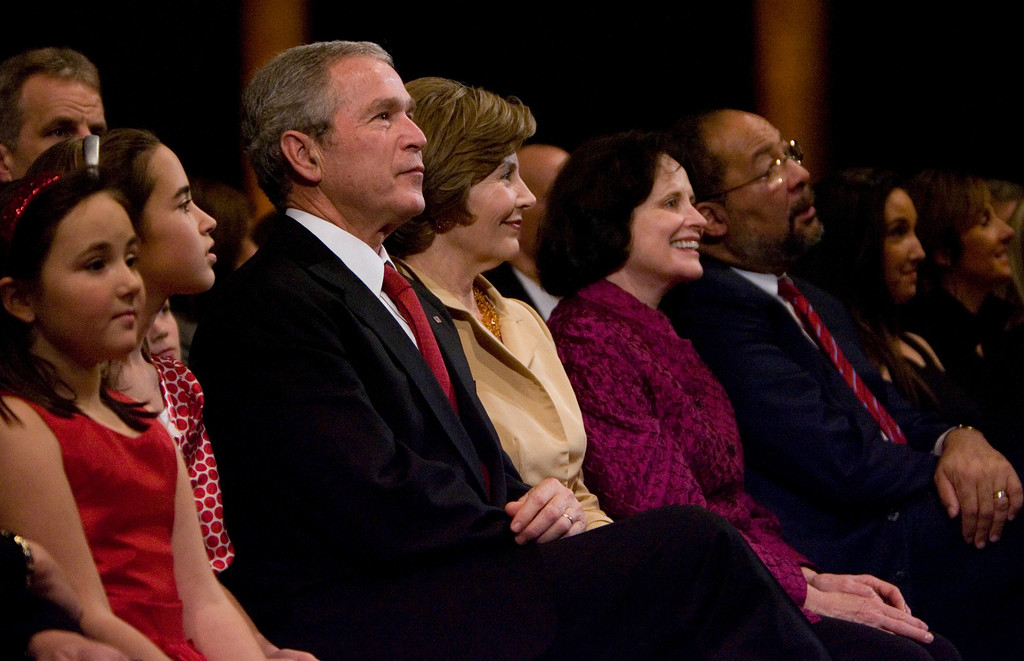 . President Bush, third from left, and first lady Laura Bush, fourth lfrom left, and Chairman and Chief Executive Officer of Time Warner Inc., Richard Parsons, third right, watch the taping of the 26th Annual Christmas in Washington, at the National Building Museum, Sunday, Dec. 9, 2007 in Washington.  (AP Photo/Manuel Balce Ceneta)