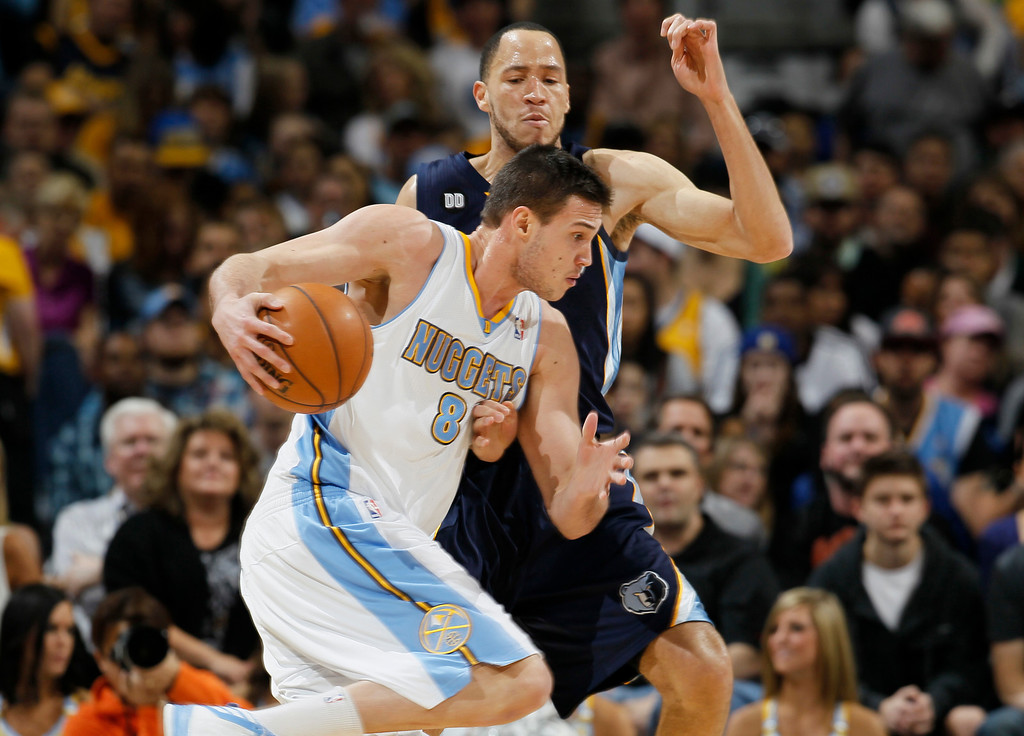 . Denver Nuggets forward Danilo Gallinari, front, of Italy, works ball inside as Memphis Grizzlies forward Tayshaun Prince covers in the first quarter of an NBA basketball game in Denver, Friday, March 15, 2013. (AP Photo/David Zalubowski)