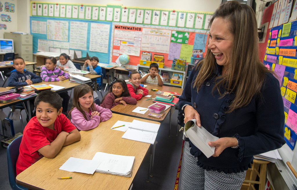 . Longfellow Elementary School principal Lily Torres looks up the longest word in the dictionary with third-graders where Whittier Elks members passed out free dictionaries at the Whittier campus April 8, 2013.  (SGVN/Staff photo by Leo Jarzomb)