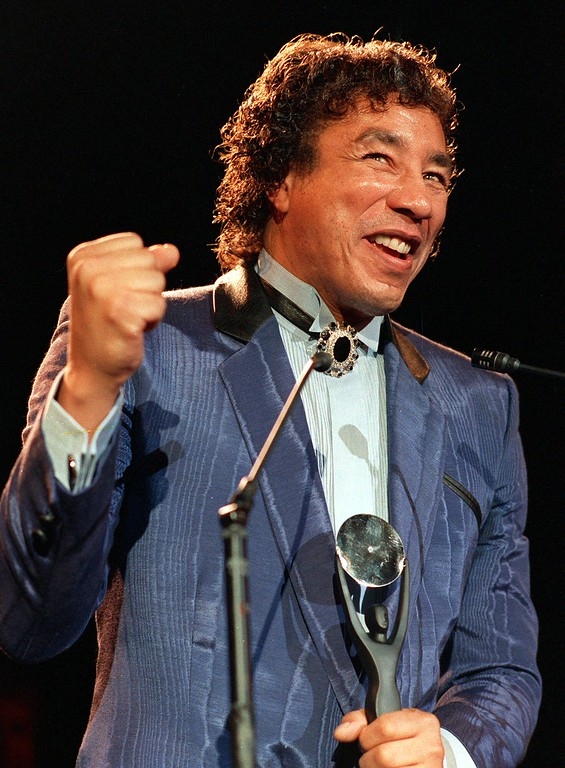 . Smokey Robinson smiles after being inducted into the Rock and Roll Hall of Fame Jan. 22, 1987 in New York.  The Hall inducted 15 founders of the music, including Aretha Franklin, the first women to receive such an honor. (AP Photo/Ron Frehm)