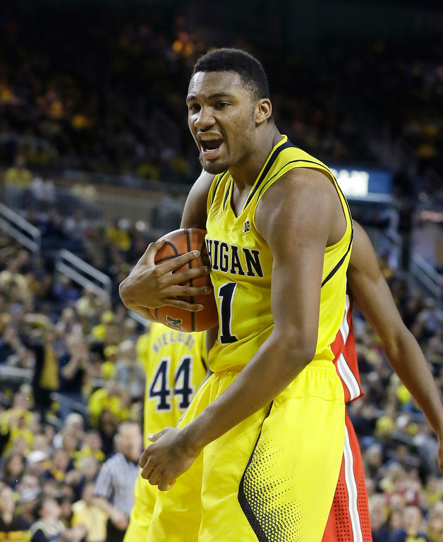 . Michigan guard Zak Irvin reacts after a play during the second half of an NCAA college basketball game against Ohio State, Sunday, Feb. 22, 2015 in Ann Arbor, Mich. Michigan defeated Ohio State 64-57. (AP Photo/Carlos Osorio)