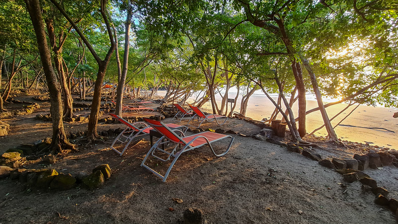 sunset on the beach with luxury beach chairs