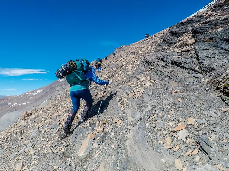 Lina Stock climbing a pass in Patagonia