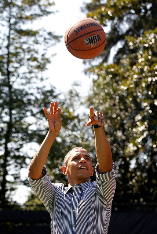 . U.S. President Barack Obama shoots during a game of basketball during the 135th annual Easter Egg Roll on the South Lawn of the White House in Washington, April 1, 2013. REUTERS/Jason Reed