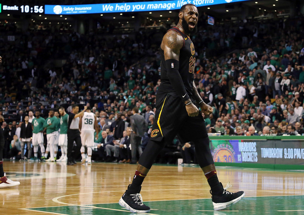. Cleveland Cavaliers forward LeBron James celebrates as his team pulls away from the Boston Celtics near the end of the second half in Game 7 of the NBA basketball Eastern Conference finals, Sunday, May 27, 2018, in Boston. (AP Photo/Elise Amendola)