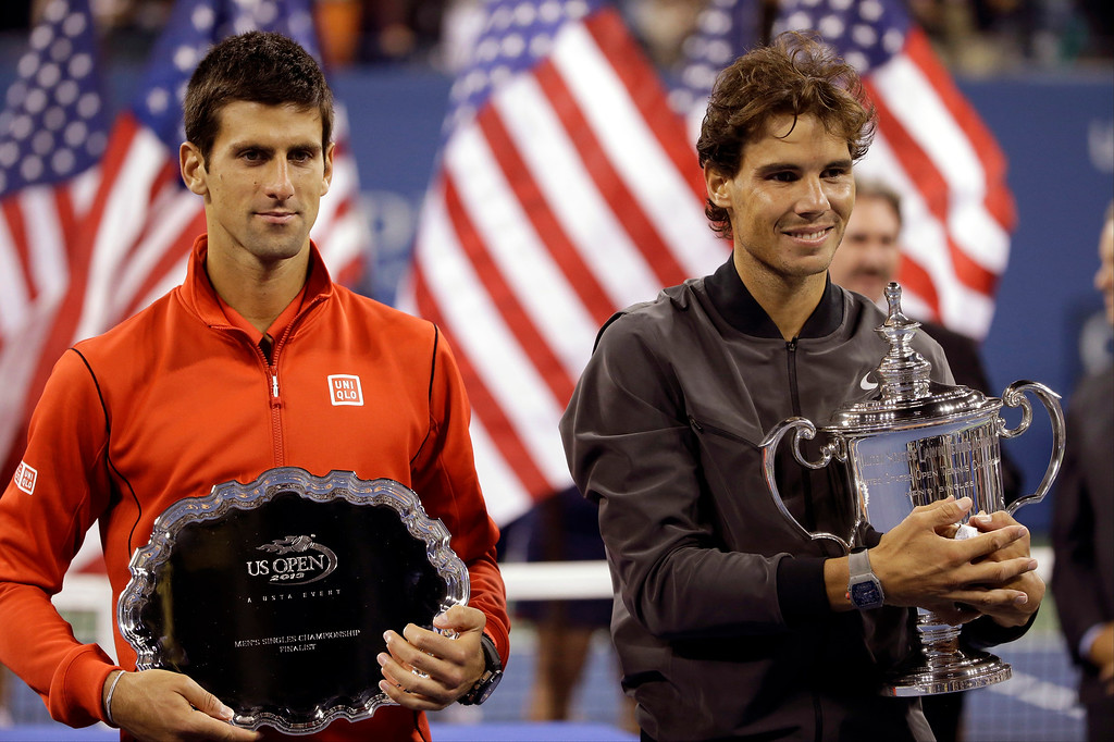 . Novak Djokovic, of Serbia, and Rafael Nadal, of Spain, pose for photos after Nadal won the men\'s singles final of the 2013 U.S. Open tennis tournament, Monday, Sept. 9, 2013, in New York. (AP Photo/David Goldman)