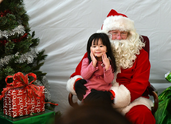 12/7/2019 Mike Orazzi | StaffrEileen Chen,2, poses with Santa during the YWCA of New Britain Winter Wonderland on Saturday in New Britain.