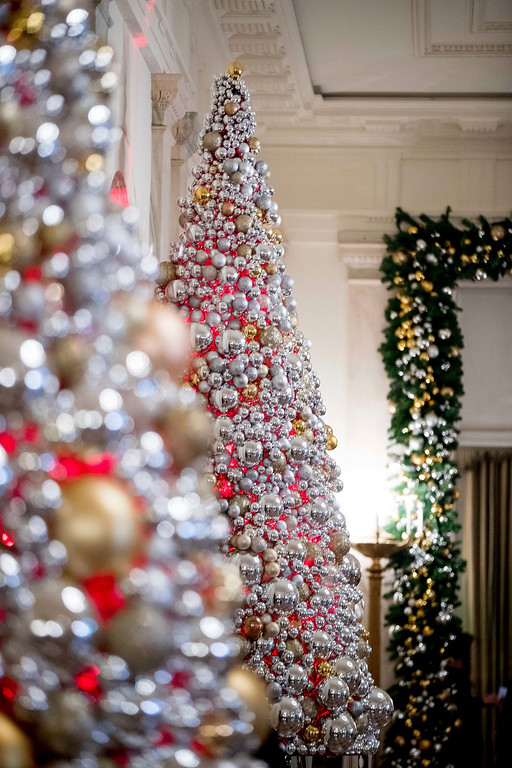 . The Cross Hall is decorated at the White House during a preview of the 2016 holiday decor, Tuesday, Nov. 29, 2016, in Washington. (AP Photo/Andrew Harnik)