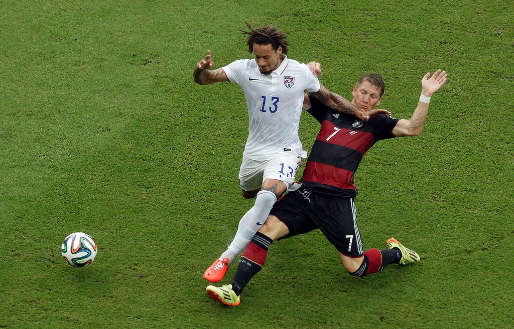 . United States\' Jermaine Jones battles for the ball against Germany\'s Bastian Schweinsteiger during the group G World Cup soccer match between the USA and Germany at the Arena Pernambuco in Recife, Brazil, Thursday, June 26, 2014. (AP Photo/Hassan Ammar)