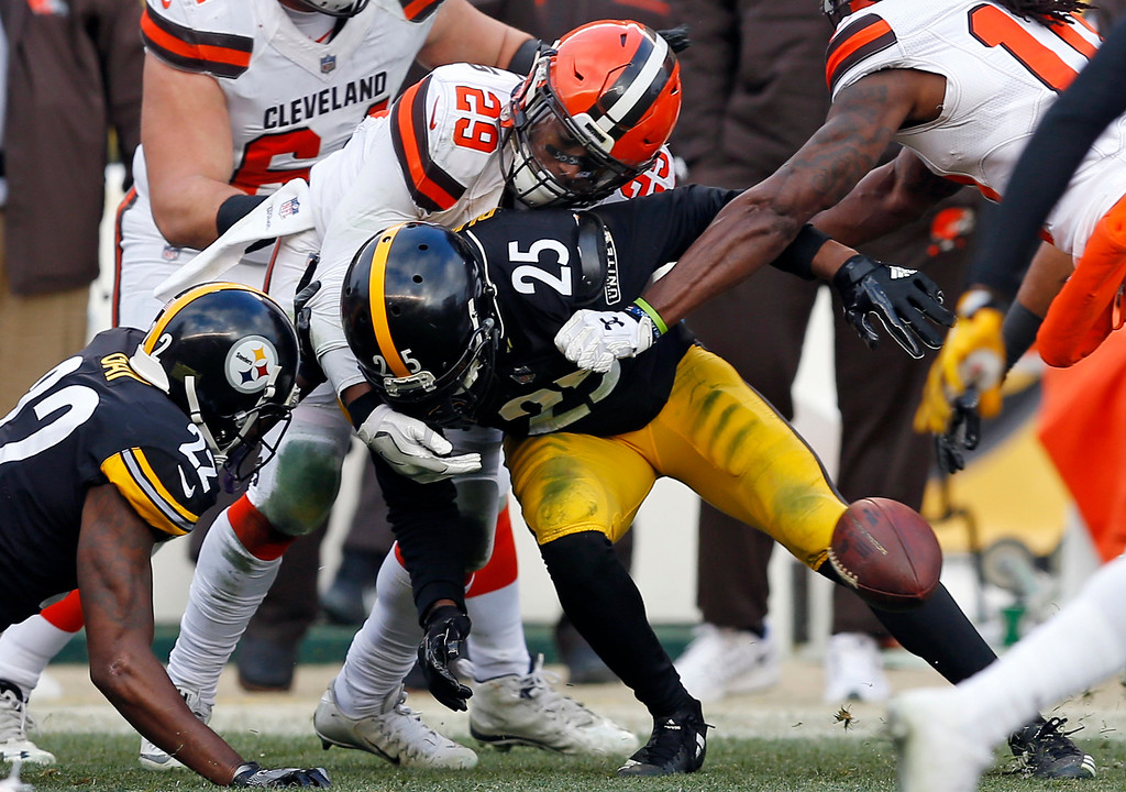 . Pittsburgh Steelers cornerback Artie Burns (25) forces a fumble by Cleveland Browns running back Duke Johnson (29) that was recovered by the Steelers during the second half of an NFL football game in Pittsburgh, Sunday, Dec. 31, 2017. (AP Photo/Keith Srakocic)