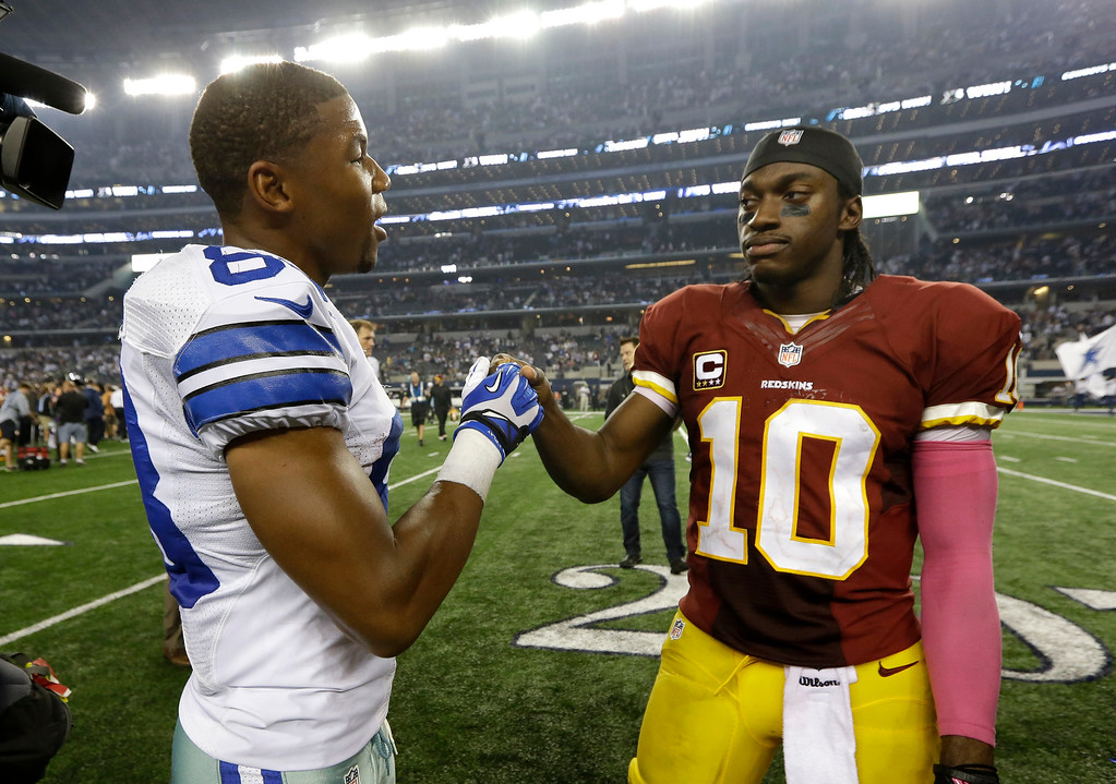. Dallas Cowboys wide receiver Terrance Williams (83) and Washington Redskins quarterback Robert Griffin III (10) greet each other after their NFL football game, Sunday, Oct. 13, 2013, in Arlington, Texas. The two were teammates at Baylor University before joining the NFL. The Cowboys won 31-16. (AP Photo/LM Otero)