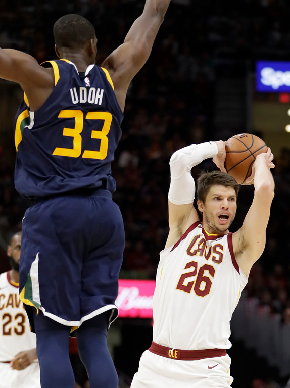 . Cleveland Cavaliers\' Kyle Korver (26) looks to pass against Utah Jazz\'s Ekpe Udoh (33) in the second half of an NBA basketball game, Saturday, Dec. 16, 2017, in Cleveland. (AP Photo/Tony Dejak)