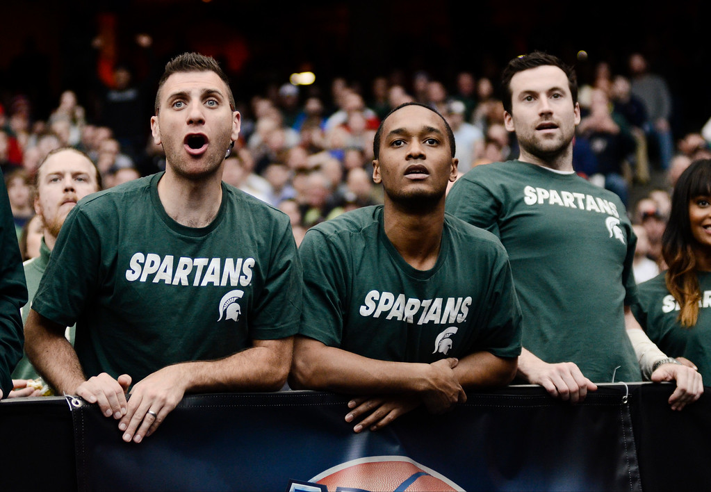 . Michigan State fans react during the second half of a regional final against Louisville in the NCAA men\'s college basketball tournament Sunday, March 29, 2015, in Syracuse, N.Y.  (AP Photo/Heather Ainsworth)