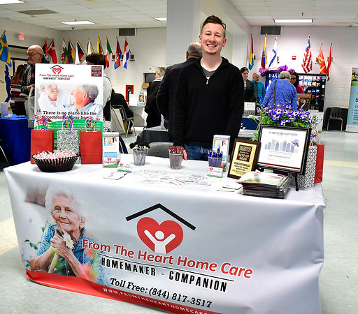 4/6/2019 Mike Orazzi | Staff From the Heart Home Care's David Karwowski during the 5th Annual Connecticut Prime Time Senior Fair Saturday at Bristol Eastern High School.