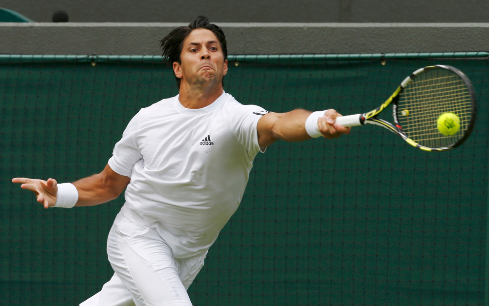 . Fernando Verdasco of Spain hits a return to Julien Benneteau of France in their men\'s singles tennis match at the Wimbledon Tennis Championships, in London June 26, 2013.         REUTERS/Suzanne Plunkett