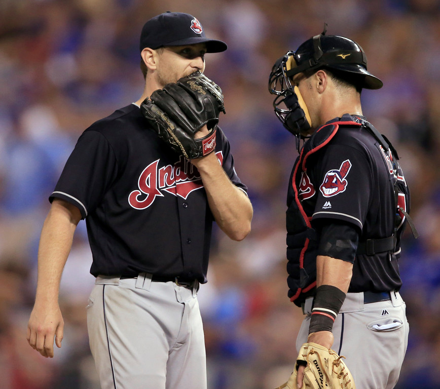 . Cleveland Indians starting pitcher Josh Tomlin, left, talks with catcher Yan Gomes during the seventh inning of the team\'s baseball game against the Kansas City Royals at Kauffman Stadium in Kansas City, Mo., Friday, June 2, 2017. (AP Photo/Orlin Wagner)