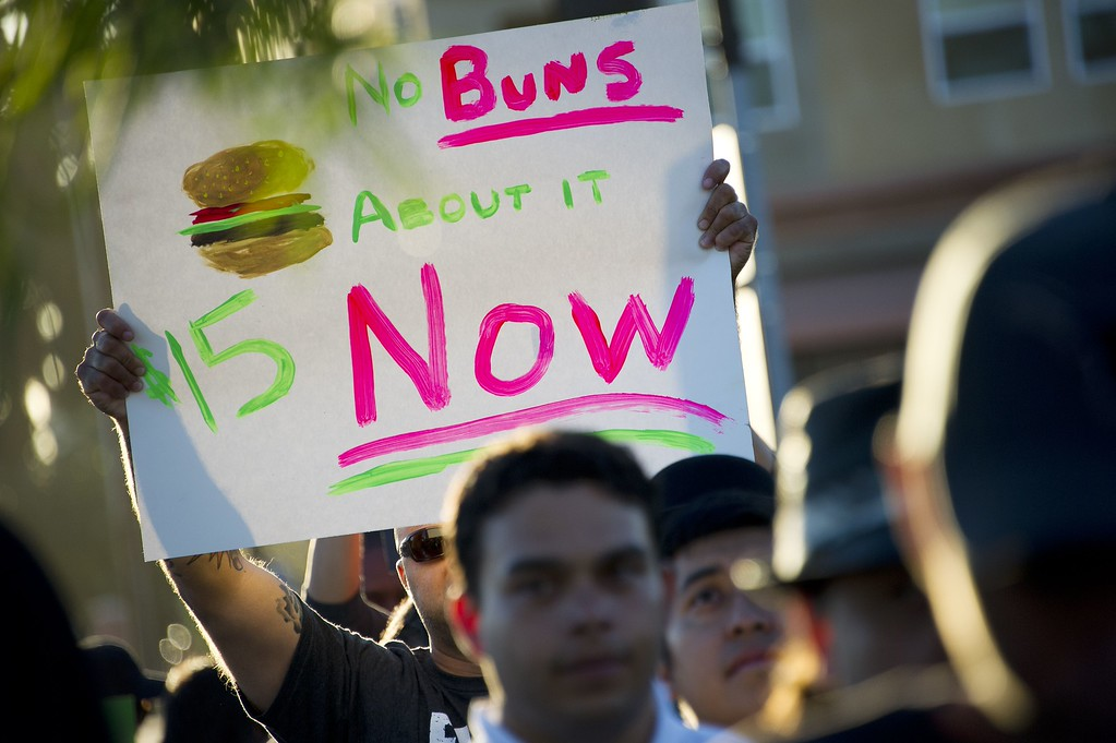 . Fast food workers and their supporters picket outside a Burger King restaurant in Los Angeles on August 29, 2013. Fast food workers walked off their jobs as part of a nationwide strike demanding higher wages and the right to form a union.     AFP PHOTO / Robyn BECK/AFP/Getty Images