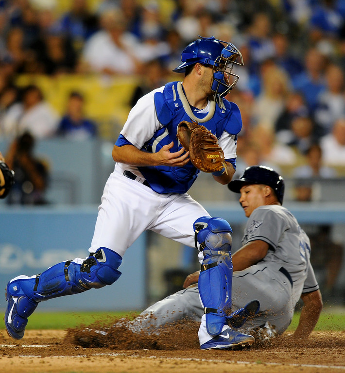 . Padres\' Will Venable is forced out at home by Dodgers\' catcher Drew Butera in the sixth inning, Friday, July 11, 2014, at Dodger Stadium. (Photo by Michael Owen Baker/Los Angeles Daily News)